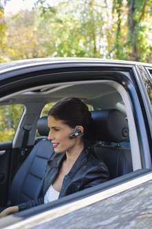 A Bluetooth headset lets you conduct business while on the go.