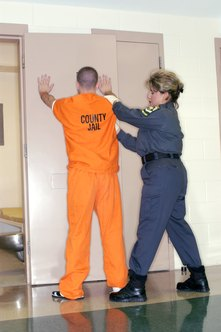 Correctional officers often search inmates for weapons and other illegal items.