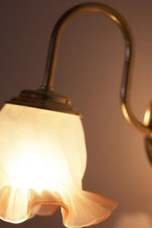 Clean a light fixture's finish with common household items.