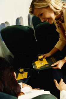 Flight attendants provide personalized service to each passenger.