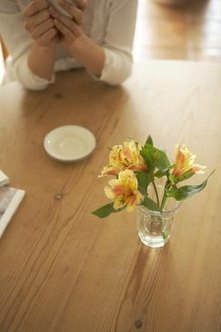Coasters or placemats prevent white rings left from drinking glasses or hot cookware.