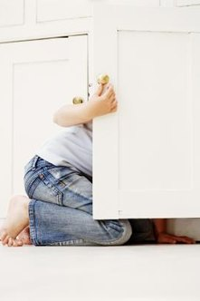Playing hide-and-go seek may be hard on cabinet doors.