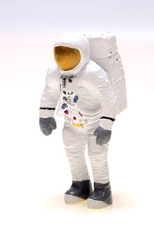 Astronauts don protective suits for space walks outside their spacecraft.