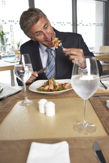 A business lunch allows you to enjoy a meal while getting to know your boss.