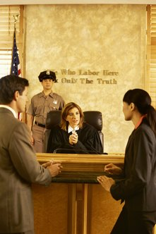 Before practicing in a courtroom, lawyers must first obtain legal schooling and pass the bar exam.