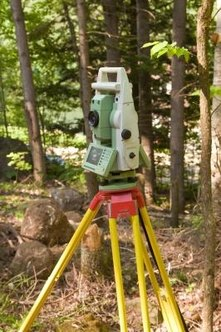Land surveyors use precise measurement instruments, such as a theodolilte.