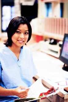 Medical assistants are responsible for various duties, such as filing patient charts.
