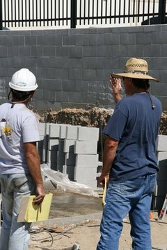 Masons on a work site.