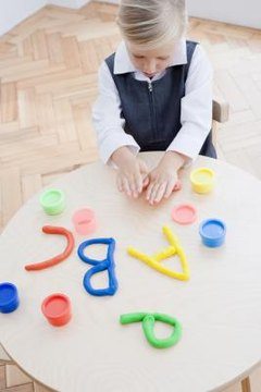 Clay adds a tactile and kinesthetic component to letter formation.