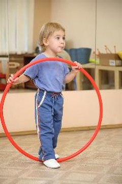 Hula hoops and preschoolers can make an enjoyable and energetic combination.