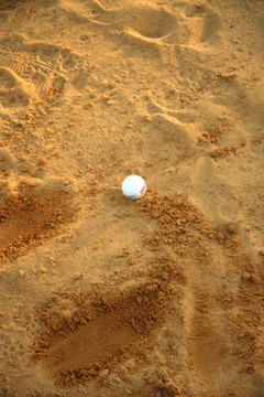 Dirt and sand on the ball can alter its flight path.