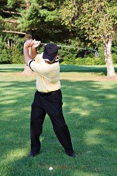 In a proper back swing, the shoulders rotate around the spine, instead of the lead shoulder.
