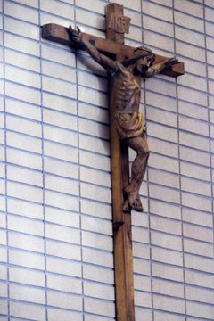 Wearing a crucifix is sometimes an indication one has been baptized.