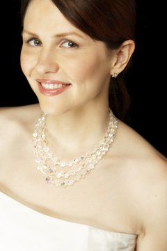 Strapless wedding dresses offer the most flexibility when choosing a necklace.