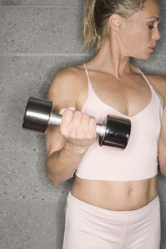 Dumbbell biceps curls develop muscular tone at the front of the arms.