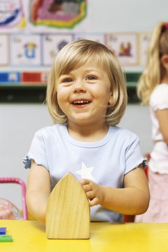 Preschoolers can pretend with props in a DAP classroom.