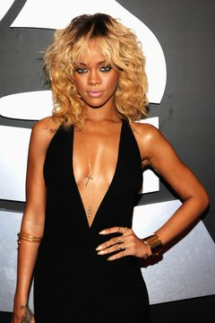 Curly bangs like Rihanna's don't fall flat as easily as straight bangs.