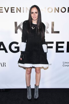 Decked out in a black and white dress and patterned shoes, Candie Weitz attends An Evening Honoring Karl Lagerfeld in New York City in November 2013.