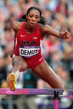 Lashinda Demus of the United States clears a hurdle in the 400 meters.