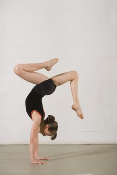 A handstand pirouette can be done with legs together or in some artistic variation.