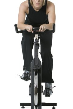 A spin bike features a weighted front wheel which mimics outdoor riding conditions.