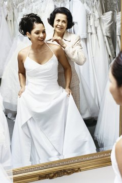 A number of aspects are involved with the cost of a custom wedding dress.