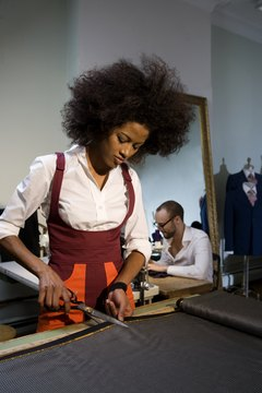 Taking studio art classes and home economics classes will prepare you to design and make clothing.