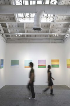 Art being shown at an exhibition is most often displayed on blank walls.