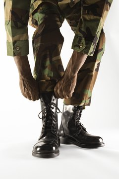 Although this uniform has been phased out of military use, blousing is still required.