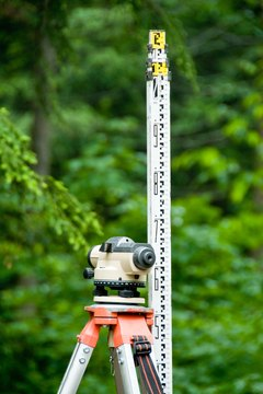 Surveyors use special tools to measure locations.