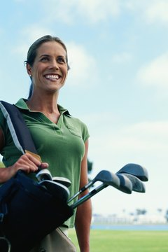 Carry your clubs if you want to slim down while playing golf.