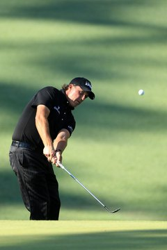 Phil Mickelson hits his lob wedge during the 2010 Masters.