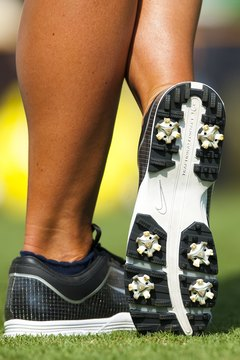Clean golf shoes and spikes will eliminate the chance of slipping during your swing.