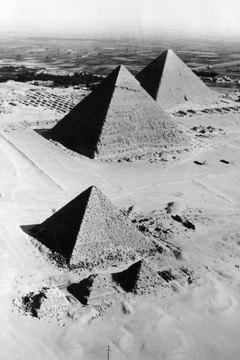Grand projects like the building of the pyramids at Giza were funded by taxation.