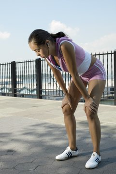 Stop your run and stretch out sore hamstrings.