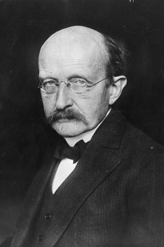 Max Planck (1858 - 1947), the German physicist who played a pivotal role in the modern understanding of particle theory