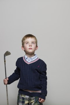 When learning golf, kids look up to adults.