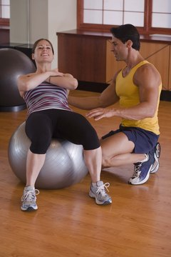 Stability balls provide support for your lower back when doing situps.