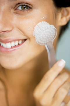 A facial brush is one way to exfoliate the skin and unclog pores.