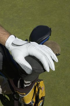 A golf glove helps a golfer grip the club while protecting against blisters.