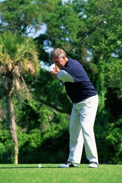 The left shoulder should be under the chin at the top of your backswing.