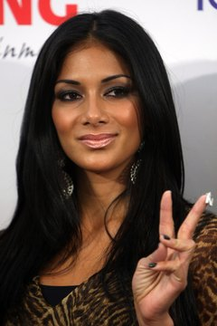 Pop star Nicole Scherzinger goes bold with triangle-style eye shadow.