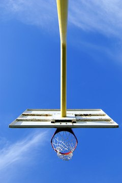 Portable basketball goals can be anchored with water or sand.