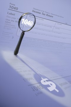 An auditor takes a close look at your tax return.