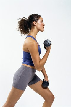 The basic lunge with dumbbells is a killer exercise for your butt and thighs.