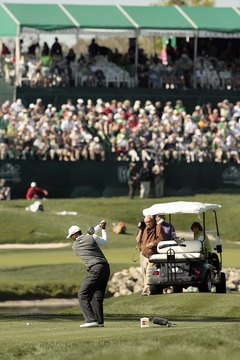 Tiger Woods turns his back to the target as he tees off during the 2007 Arnold Palmer Invitational.