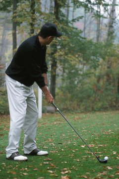 Maintain good posture and alignment for a successful fairway wood shot.