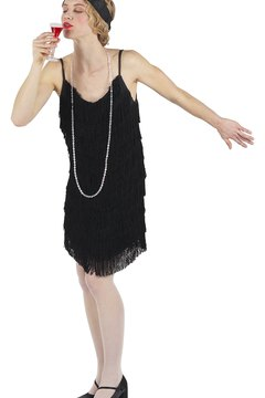 The looser dress styles of the 1920s allowed young women to dance popular dances like the Charleston.
