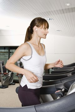 Keep your arms low and your head forward as you run on a treadmill.