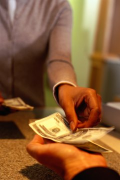 Several services can help you cash checks and shop safely without a bank account or debit card.